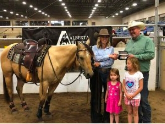 Rob Dewes, on behalf of Tower Tack, presenting buckle to winner at 2018 Alberta Reined Cow Horse Association (ARCHA) show.